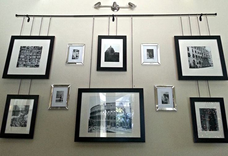 Gallery frames hanging by chain from a curtain rod with for Hanging frames on walls