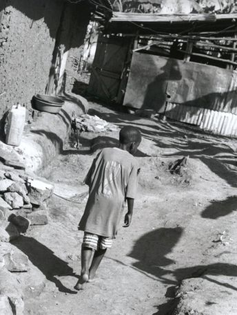 Walking home, Eden Slum, Kampala, Uganda