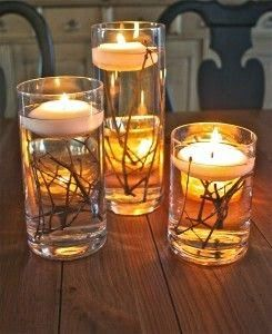 Cool modern centerpiece. love the floating candle.