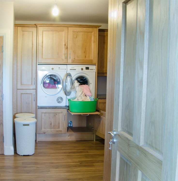 A raised washer and dryer in the utility room. Kitchen done by Newhaven Kitchens Carlow.