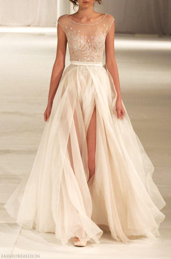 Sleek sheer illusion bateau neckline wedding dress with gorgeous tulle skirt; Featured Dress: Paolo Sebastian