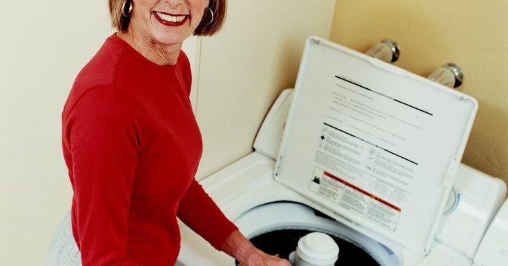 ¿Por qué mi lavadora de carga superior gotea por abajo?