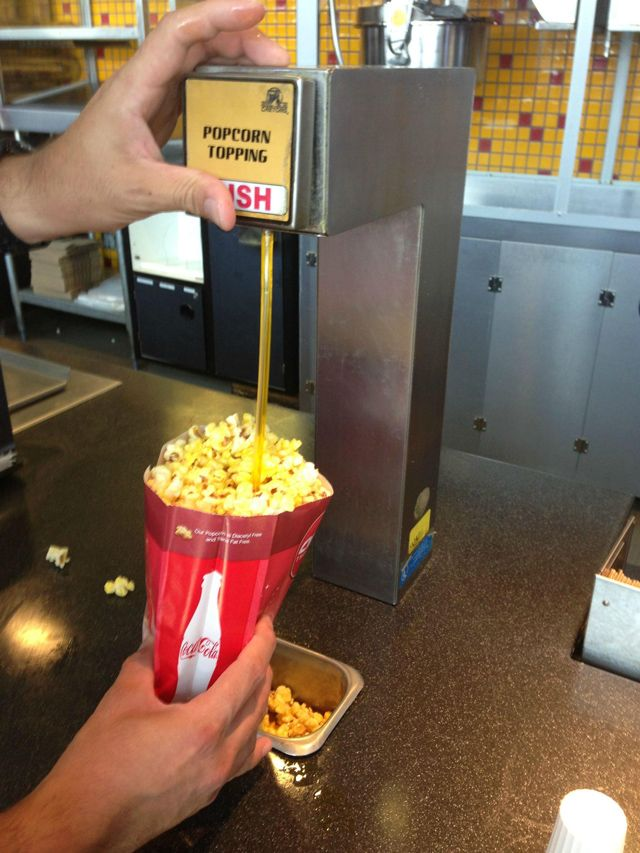 Clever ... using a straw to get butter on more of the popcorn in your bag at the movies!