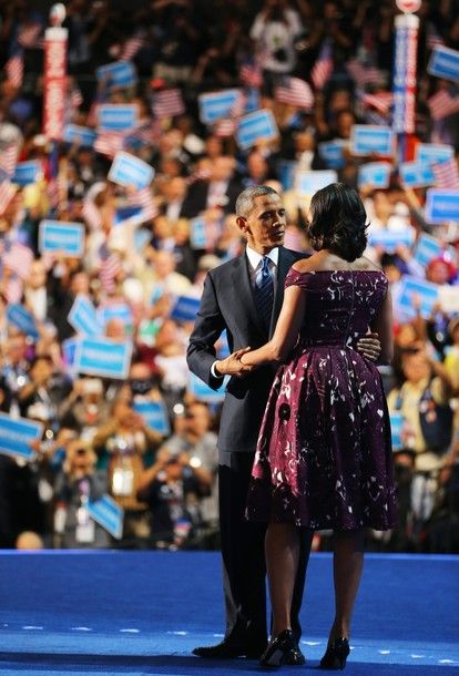 Democratic presidential candidate, U.S. President Barack Obama greets First lady Michelle Obama on stage during the final day of the Democratic National Convention at Time Warner Cable Arena on September 6, 2012 in Charlotte, North Carolina. (via...