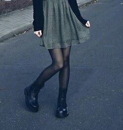 Is just do different shoes but I love the green with the black tights.