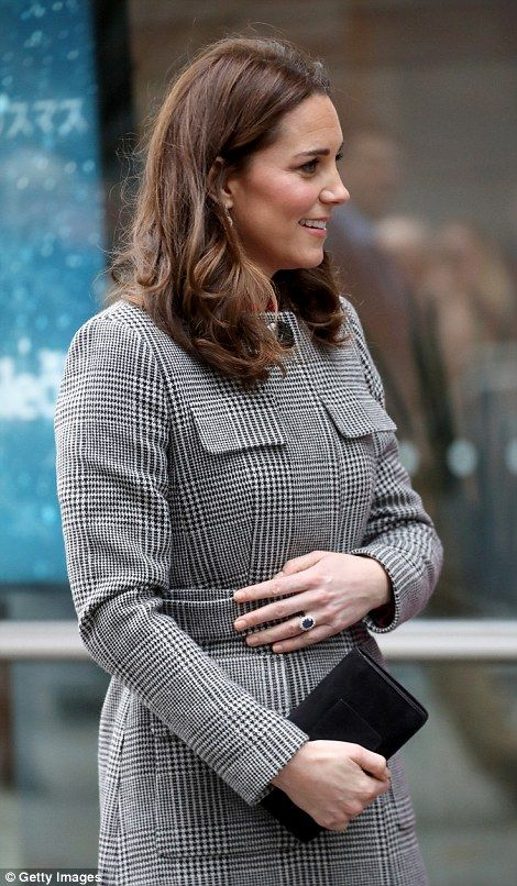 At one point she placed a protective hand on her bump as she made her way into the event...
