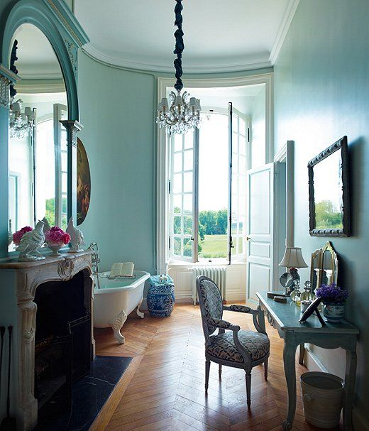 When decorator Timothy Corrigan appointed this unabashedly romantic bathroom, we imagine he envisioned it as a place for two to catch up at the end of the day. While most of us may not have a French chậteau that boasts herringbone wood floors and a claw-foot tub, a coat of serene blue paint just may make a bathroom a most fitting place to soak it all in.  Paint color: Oval Room Blue by Farrow  Ball
