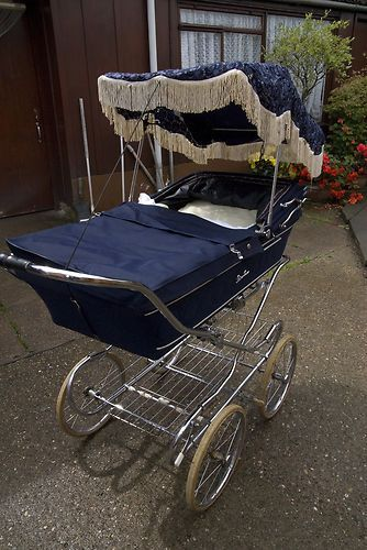Vintage Silver Cross Pram early 20th century.  Way to ride in style.  Makes me want to nap.