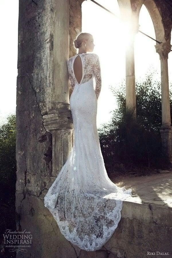 Lace wedding dress with sleeves and open back, long train. Because lace is the jam.
