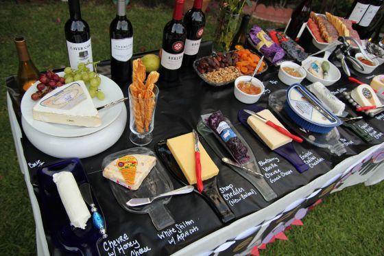 "Wine tasting party ""Red Wine"" table with appetizer pairings and tons of cheese!! #winetasting #cheeseandwine #winepairiings"