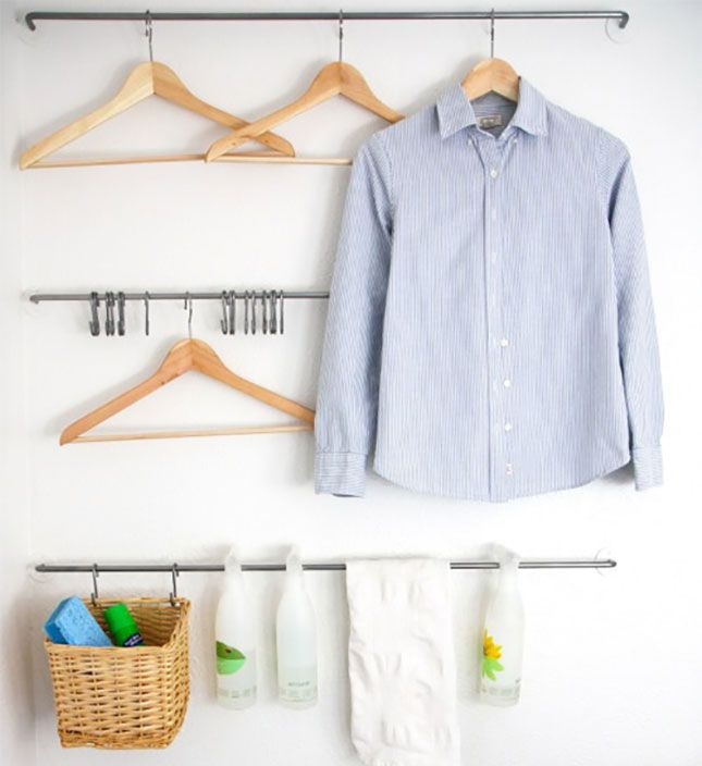 Use towel racks to hang shirts, baskets, and more in your laundry room.