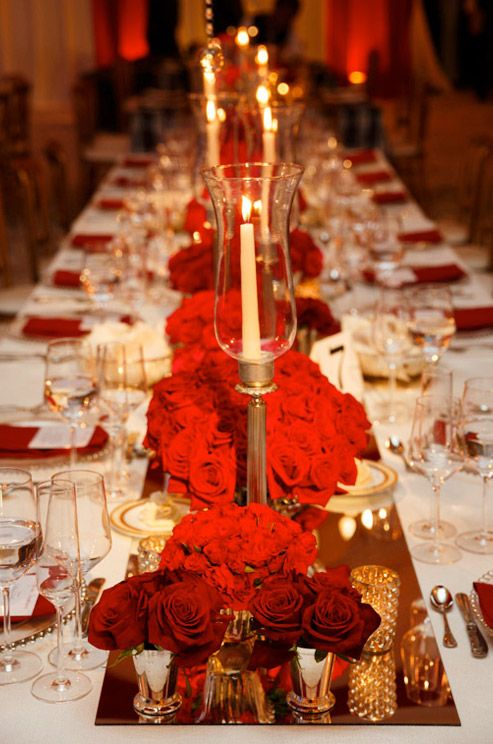 Regal and Formal- For this wedding guest tables were decorated with a mix of different linens and mirrored runners.