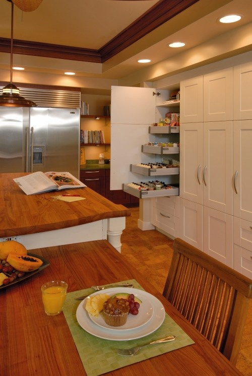 What a way to make use of cupboards... now you can get to the back with ease. Make use of the whole thing!