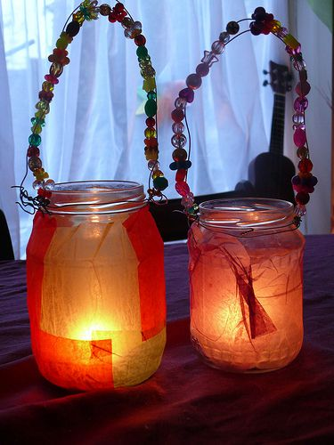 Martinmas Lanterns made with tissuepaper and beads. I love the tissue paper around the jars. I might want to do the handle differently.