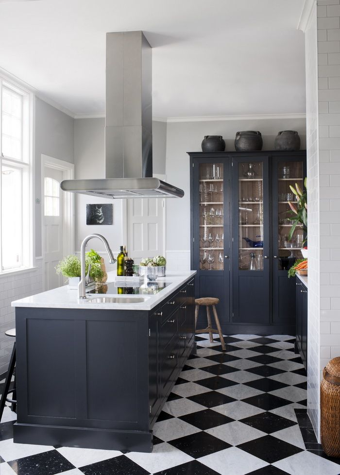 dark blue kitchen..  home decor and interior decorating ideas.  bold floor.