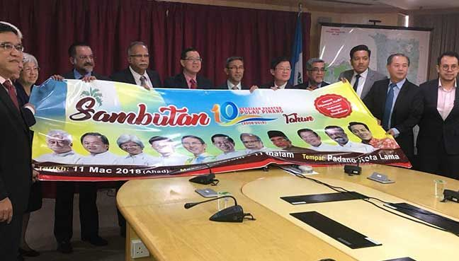 Guan Eng hints at important announcement on 10th anniversary   Guan Eng hints at important announcement on 10th anniversary  Melissa Darlyne Chow  Guan Eng pakatan 1: Penang Chief Minister Lim Guan Eng (fifth from left) and his state executive councillors holding up a banner for the 10th year anniversary celebrations at the Esplanade on March 11.  GEORGE TOWN: The Penang government will be holding a gathering to celebrate 10 years of governance of the northern state with Chief Minister Lim…