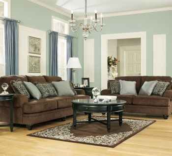 Crawford Chocolate living room set by Ashley Furniture. Has matching accent chair with the same paisley and brown fabric as the throw pillows!