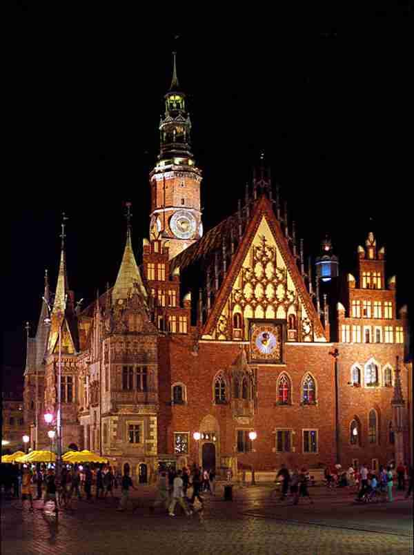 Wrocław, Poland.  Center of town.  If you like to drink cold barley soup, then the bar in the basement of this building is the place for you.  It is the old city hall.