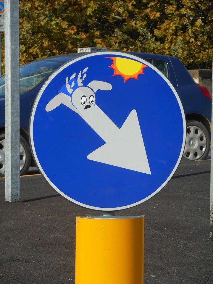 Clet urban art street art sign