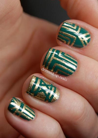 Different stripe patterns with gold polish #nailart #nails #womentriangle