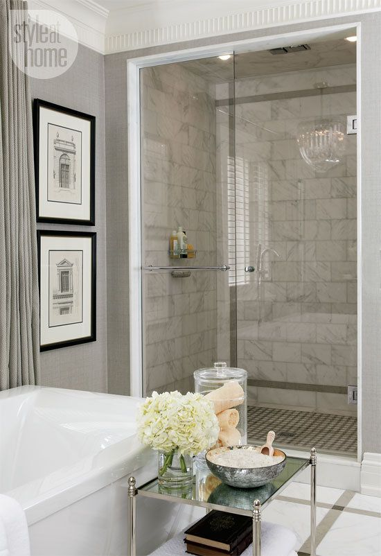 A gorgeous greige bathroom with a marble-tiled open shower
