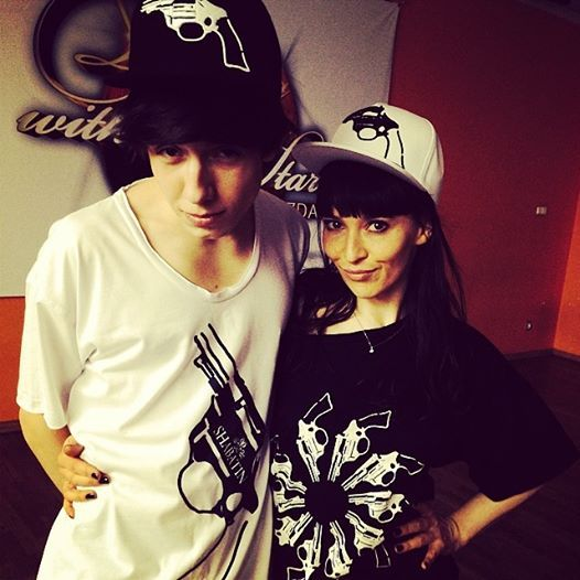 Dawid Kwiatkowski - singer and Janja Lesar - dancer in Shabatin revolver t-shirts and caps.
