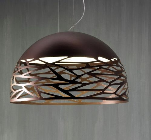 This sphericalpendant lamp produces ambient illumination and is perfect for use in bedrooms, offices and living room spaces. The metal body features laser cut openings that create a play of light and shadow. Glass inner diffuser.