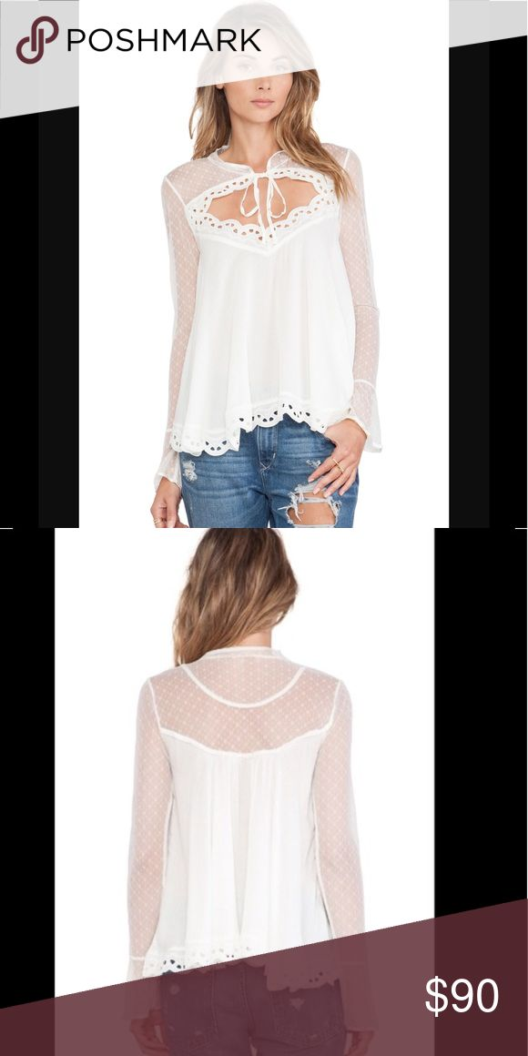 NWT! Free people black majic blouse in S! Brand new, never worn, black majic blouse from free people, gorgeous sheer accents on arms, and around shoulders, with a tie front. Sz S Free People Tops