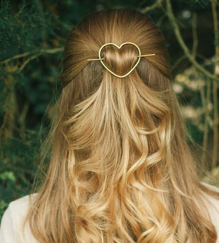 Accessorize your tresses with this sweet metal hair barrette. Each one is hand hammered in Brass, Rustic Copper, or German Silver, the thick wire sturdy enough to hold up even thick and heavy hair. Simply place the organically shaped heart over a twist or small bun, and use the hair stick to hold your hairdo in place.