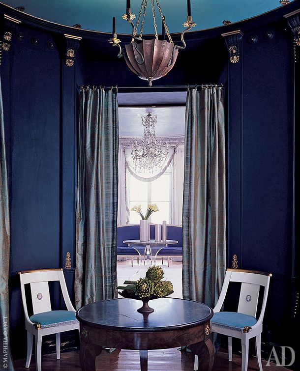 A small but dramatic space with saturated blues and strong neoclassical leanings...that light fixture is EVERYTHING...