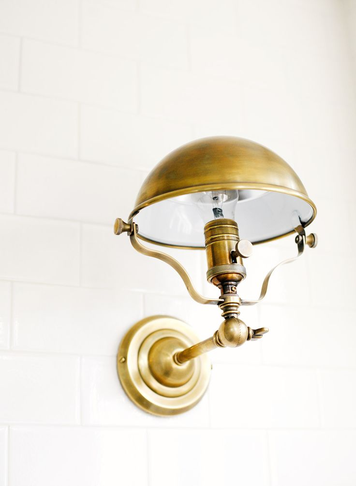 Brass wall sconce with industrial feel