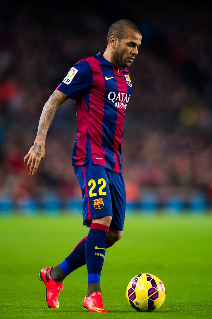 Dani Alves of FC Barcelona runs with the ball during the La Liga match between FC Barcelona and Club Atletico de Madrid at Camp Nou on January 11, 2015 in Barcelona, Catalonia.