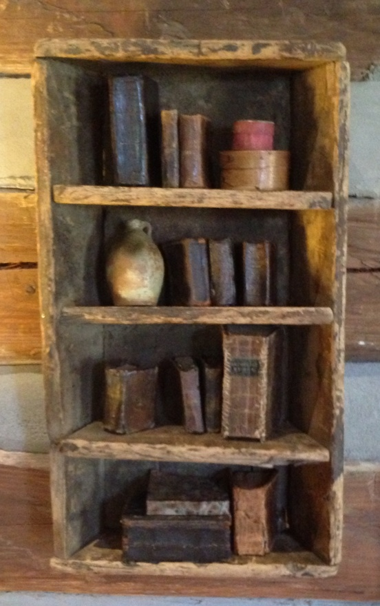 Prim bookcase and olde books