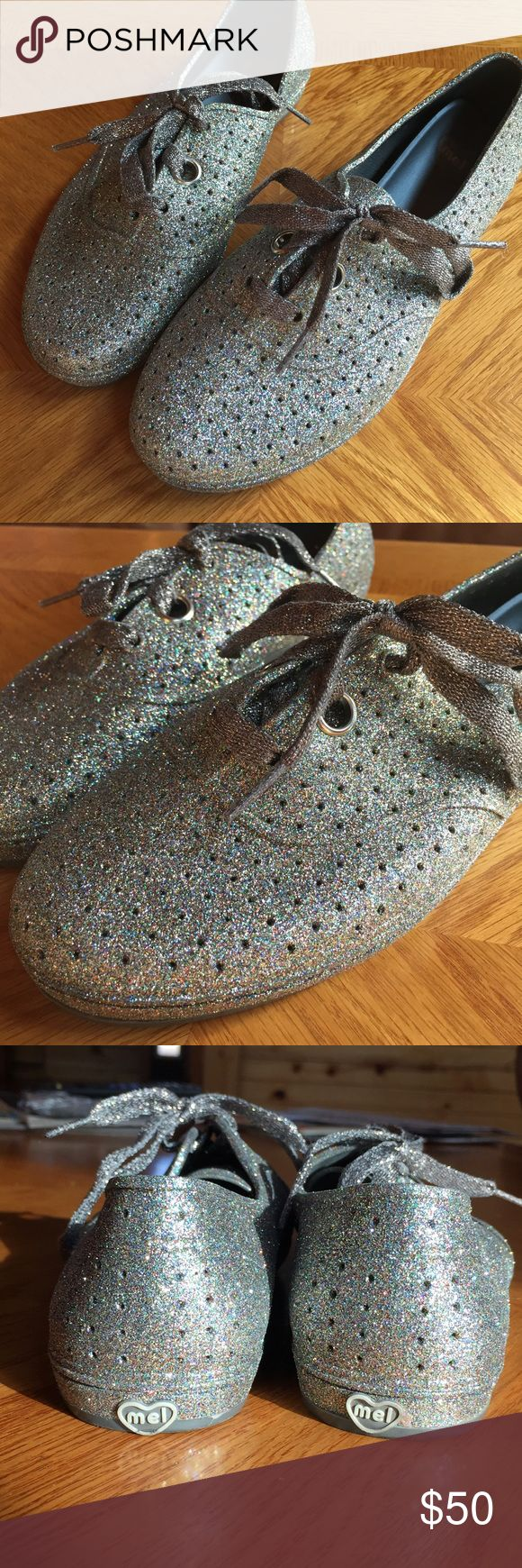 New! Melissa Sparkle Jelly Shoes Never worn outsider! Mel dreamed by Melissa jelly shoes! Keds like style. Seriously sooo Sparkly in the sun! Perfect for any glitter loving fan. Melissa Shoes Flats & Loafers