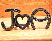 horseshoe art from hinges to monograms to stands that could be turned into tables.  Absolutely love it.