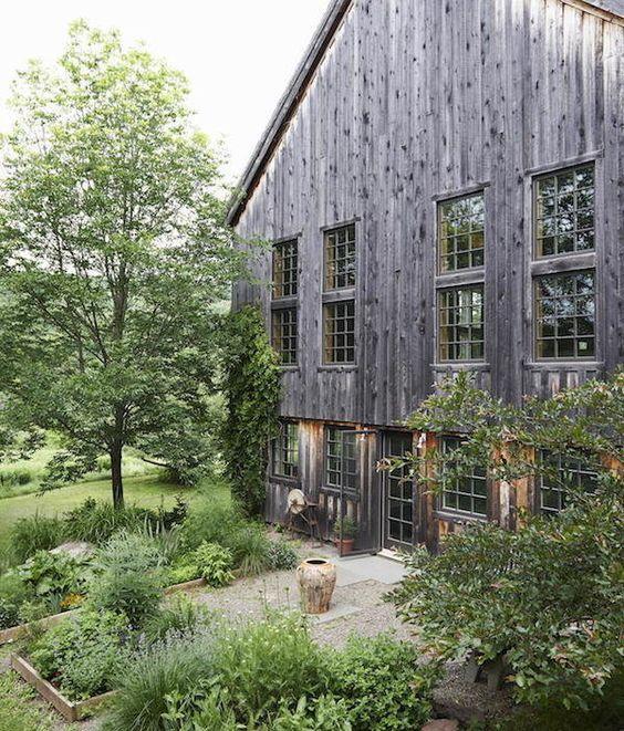 Green garden against dark barn