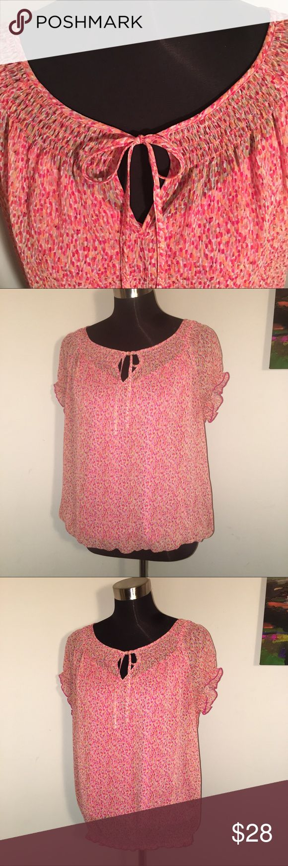 🆕 LIZ CLAIBORNE 2-PIECE BLOUSE SET 🆕 Fun pink and orange watercolor print blouse set by Liz Claiborne. Sheer outer top has scoop neck with smocked neckline and tie in front. Cap sleeves with elastic that creates tiny ruffle. Waist has same smocking as neckline and can be turned under for slight blouson effect. (See second photo). Pink Cami is attached to over blouse at back shoulder seam. Both are machine washable polyester. Smoke free. I ❤️ reasonable offers. Bundle for further discount…