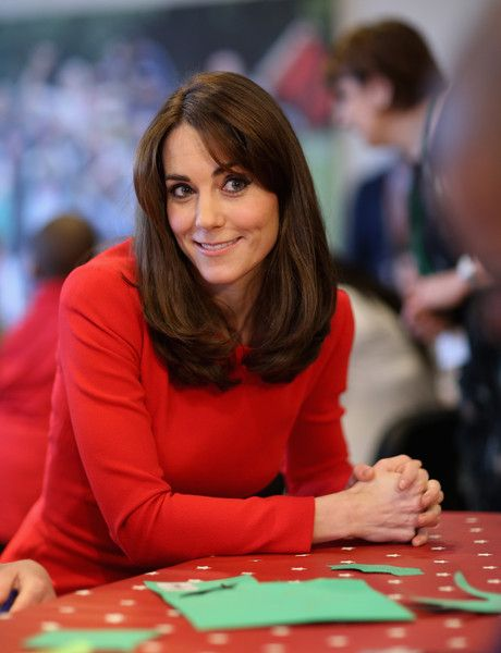 Catherine, Duchess of Cambridge takes part in some drumming 'music therapy' as she attends the Anna Freud Centre Family School Christmas Party at Anna Freud Centre on December 15, 2015 in London, England. The Duchess joined groups of families in Festive activities designed to help pupils reflect on the positive progress in their social relationships and communication skills.: