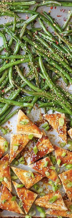 Simple Sheet Pan Sesame Tofu and Green Beans Recipe. Sheet pan dinners and suppers are the ultimate in one pan recipes. This quick and EASY dish is great for a weeknight meal or a sunday supper with your family. This Asian inspired dinner features extra firm tofu, soy sauce or tamari, garlic, honey, ginger, sesame oil, green beans, red pepper flakes, and scallions.