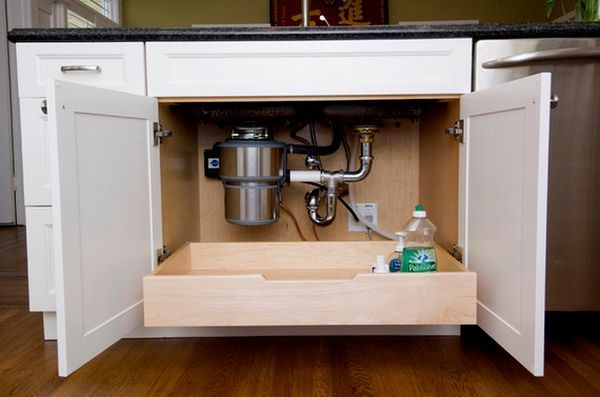 19-pull-out-drawer-under-sink. But maybe the metal ones are just as good (stainless steel). I'm envisioning this wood version looking pretty bad after chemical spills and leaks that take their toll on beautiful wood. Love the idea. But let's make it a resilient material so it looks good 20 years down the road.