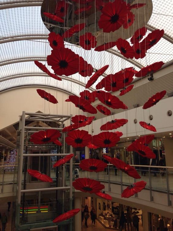 Large hanging poppy chain in a public shopping mall