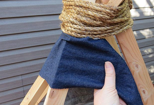 Wrap the fabric around the teepee frame.