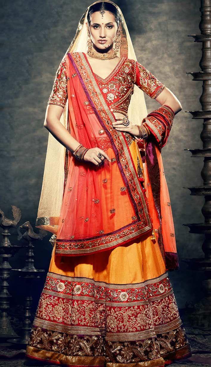 Beautiful Bollywood Orange Manipuri Silk Bridal Wear Lehenga Choli !  For more information, visit Efello.com .