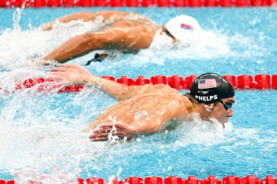 Milorad Cavic of Serbia and Michael Phelps of the U.S. compete in the Men's 100m Butterfly Final in the 2008 Beijing Olympics.