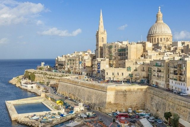 The Valletta skyline with the dome of the Carmelite Church and St. Pauls Anglican Cathedral.