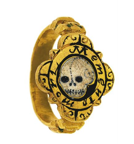 A mid 16th/early 17th century gold and enamel 'memento mori' ring   The heavy gold ring with flattened quatrefoil bezel the centre with painted white enamel skull on black enamel ground, the border with black enamel legend mememto mori the engraved scrolling shoulders with traces of white and green enamel, the reverse with indistinct goldsmith's privy mark, circa 1600,