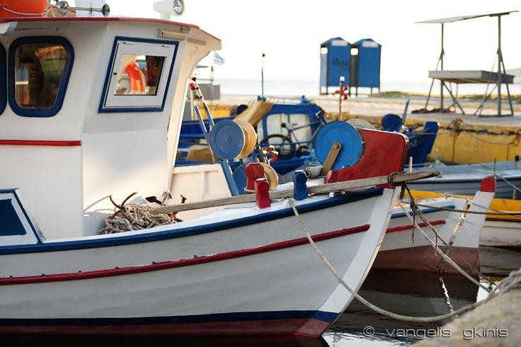 Boats floating at Elefsina's port.