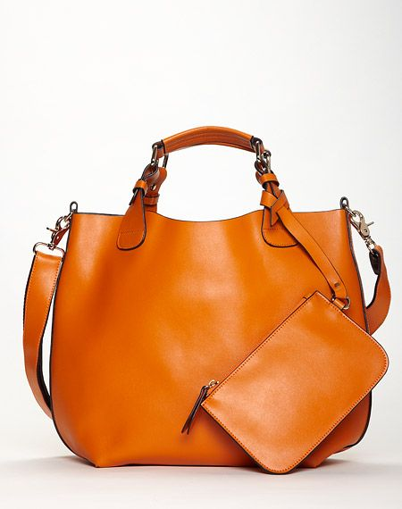 Danier orange leather bucket tote... the structure and shape of this bag make it timeless. Comes in a gorgeous dark blue too.