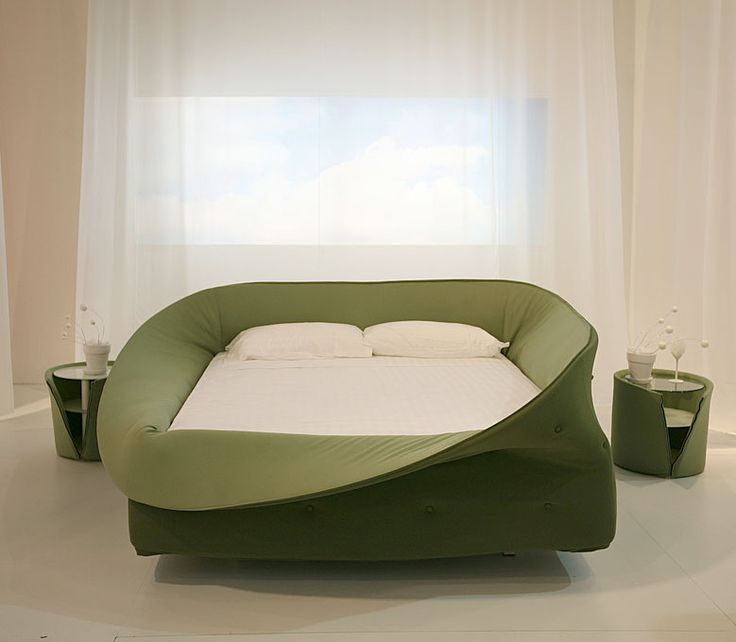 The COL-LETTO bed, which received this year's Elle Decor International Design award, designed by Nuša Jelenec and produced by Lago of Italy is womb-like in its appearance.  ----- Love it.....it's like a crib for grown-ups - kelly