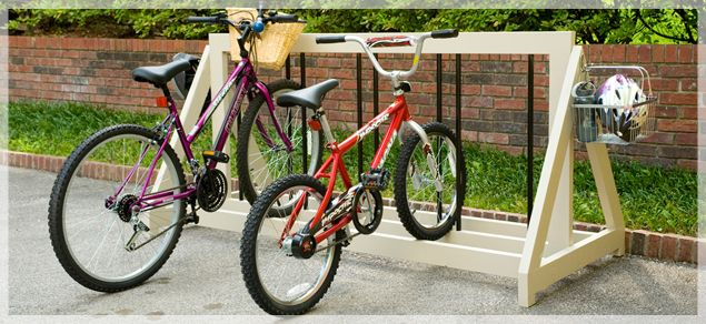 Make your own bike rack - http://www.lowescreativeideas.com/idea-library/projects/bike_rack_0809.aspx